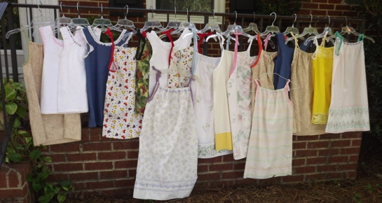 colorful little dresses hanging on a line